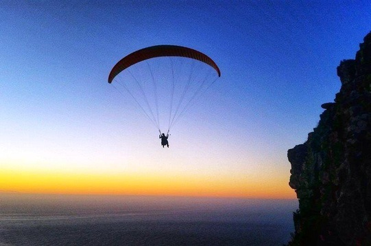Paragliding off Lion's Head in Camps Bay