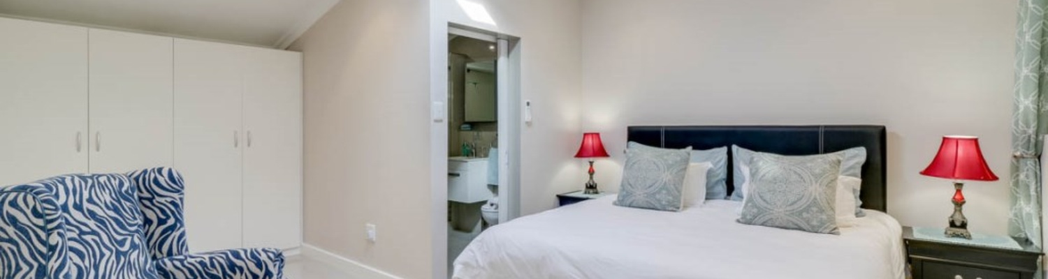 The master bedroom offers a king sized bed, hairdryer, safe and en suite bathroom.