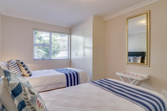 The second bedroom offers a wardrobe with views of the Twelve Apostles Mountain Range.