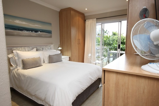 The main bedrooms offers a double bed and leads onto the patio.
