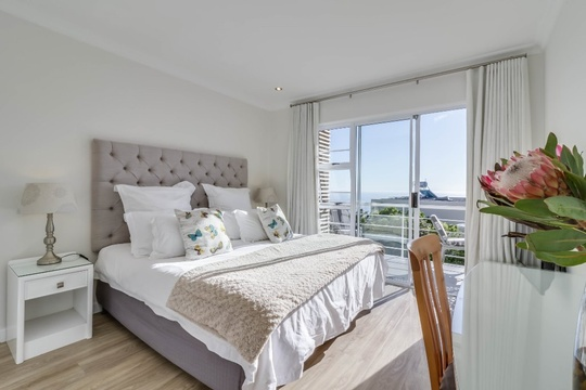 The master bedroom has a king sized bed, hairdryer, safe, ample wardrobe space and leads onto the balcony