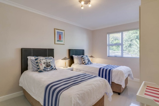 Second bedroom offers two single beds that can be converted into a king sized bed.